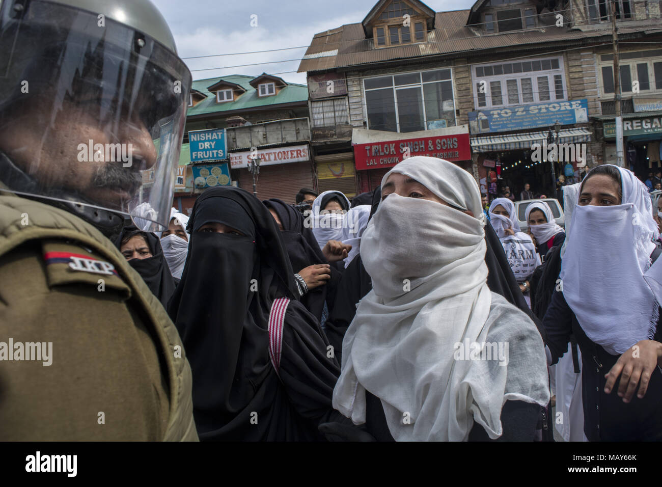 Srinagar, Jammu And Kashmir, India. 5th Apr, 2018. Kashmiri student protesters shout Anti Indian and Pro freedom slogans in front of a Indian Security force in Srinagar, the summer capital of Indian administered Kashmir, India. Heavy clashes erupted between Kashmiri students and Indian government forces in different parts of Srinagar on Thursday. Extreme Violence erupted after the students of different educational institutes and staged protests in the city's commercial hub Lalchowk. The authorities earlier in the day had ordered all colleges and higher secondary schools open. Students prote - Stock Image