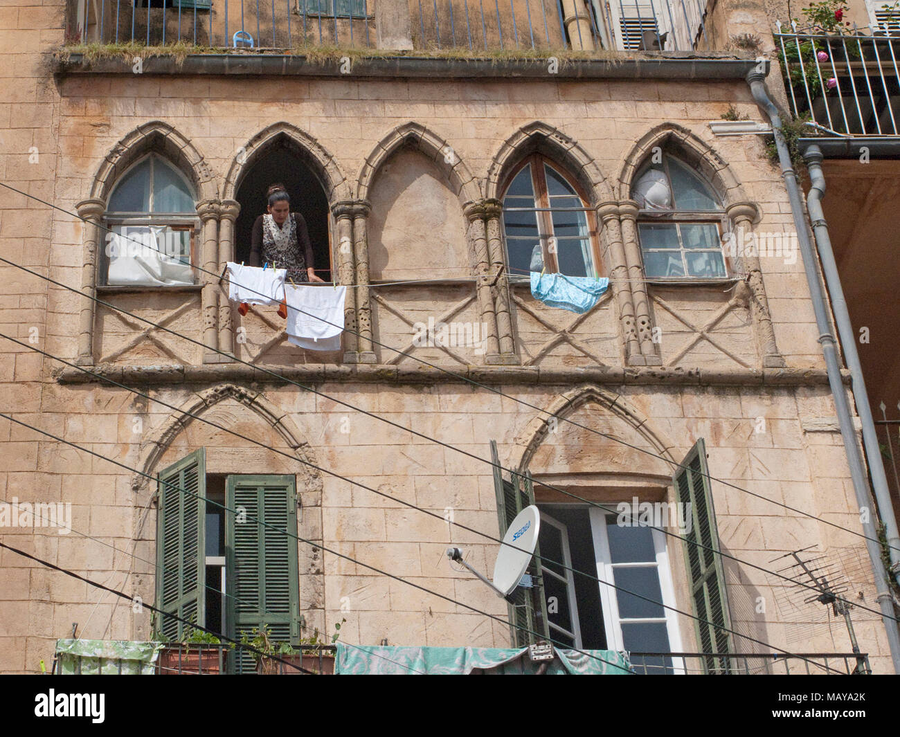 House facade with out hanging laundry, old town of Grasse, Alpes-Maritimes, South France, France, Europe Stock Photo