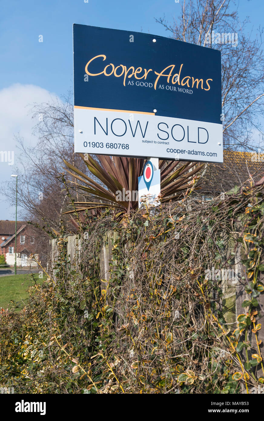 House now sold sign from Cooper Adams estate agents in England, UK. - Stock Image