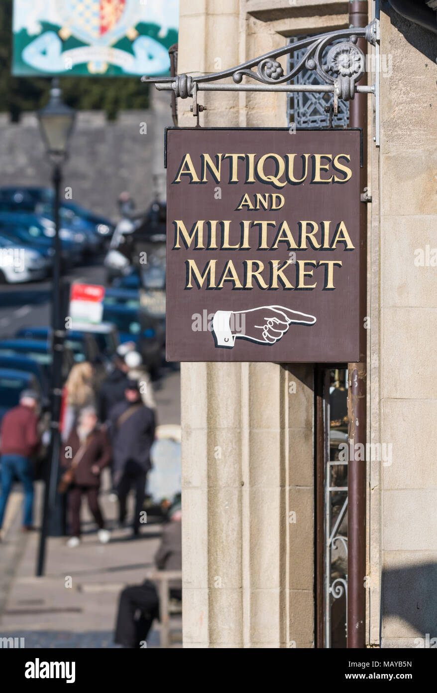 Hanging sign pointing to Antiques and Militaria Market in Arundel, West Sussex, England, UK. - Stock Image