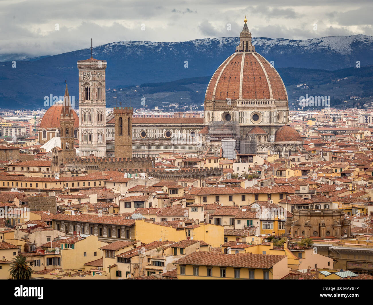 The Cattedrale di Santa Maria del Fiore. Florence, Italy, cathedral. In background there are mountains in the snow - Stock Image