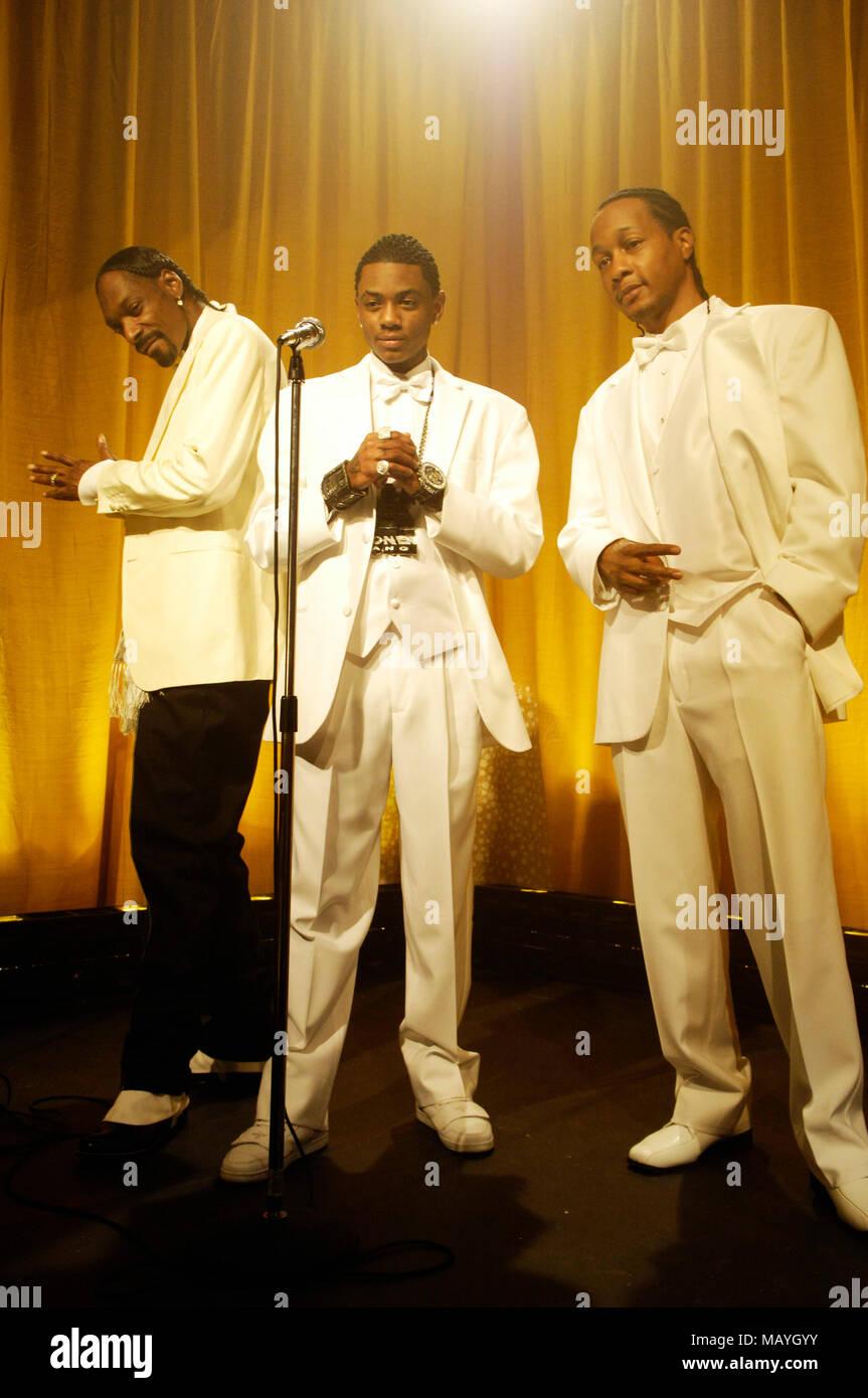 L-R) Rappers Snoop Dogg, Soulja Boy and DJ Quik on set at