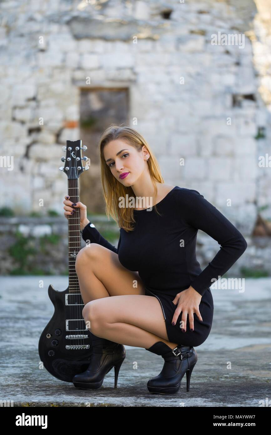 Attractive young woman and guitar musician image photo photography photograph alpfabet Stock Photo