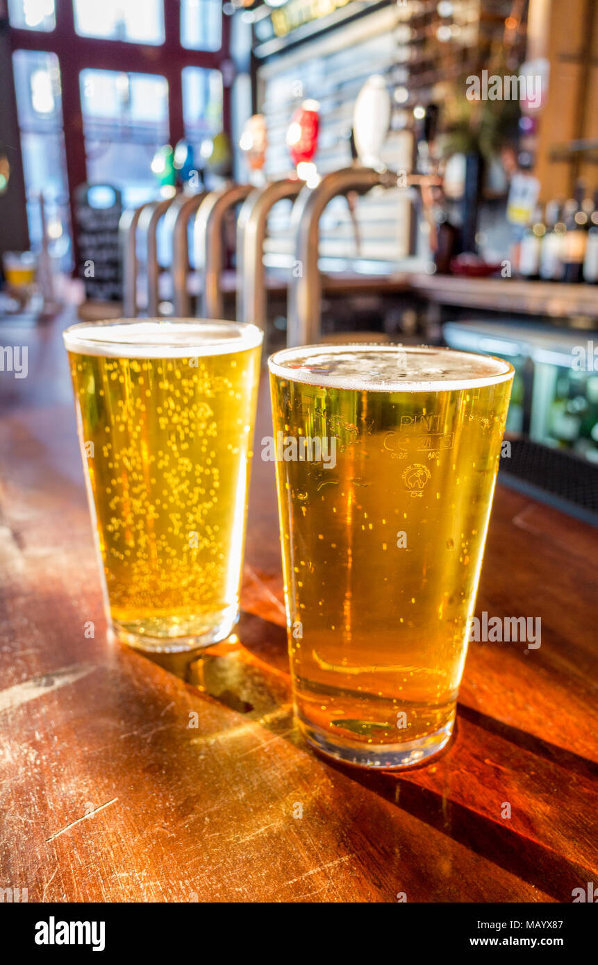 Close up of two pints of lager on the bar of a pub, UK, London Stock Photo