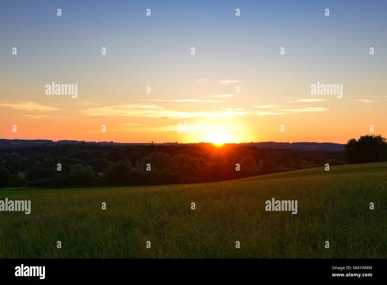Sunset over the Pupplinger Au near Ergertshausen, municipality of Egling, Upper Bavaria, Bavaria, Germany - Stock Image