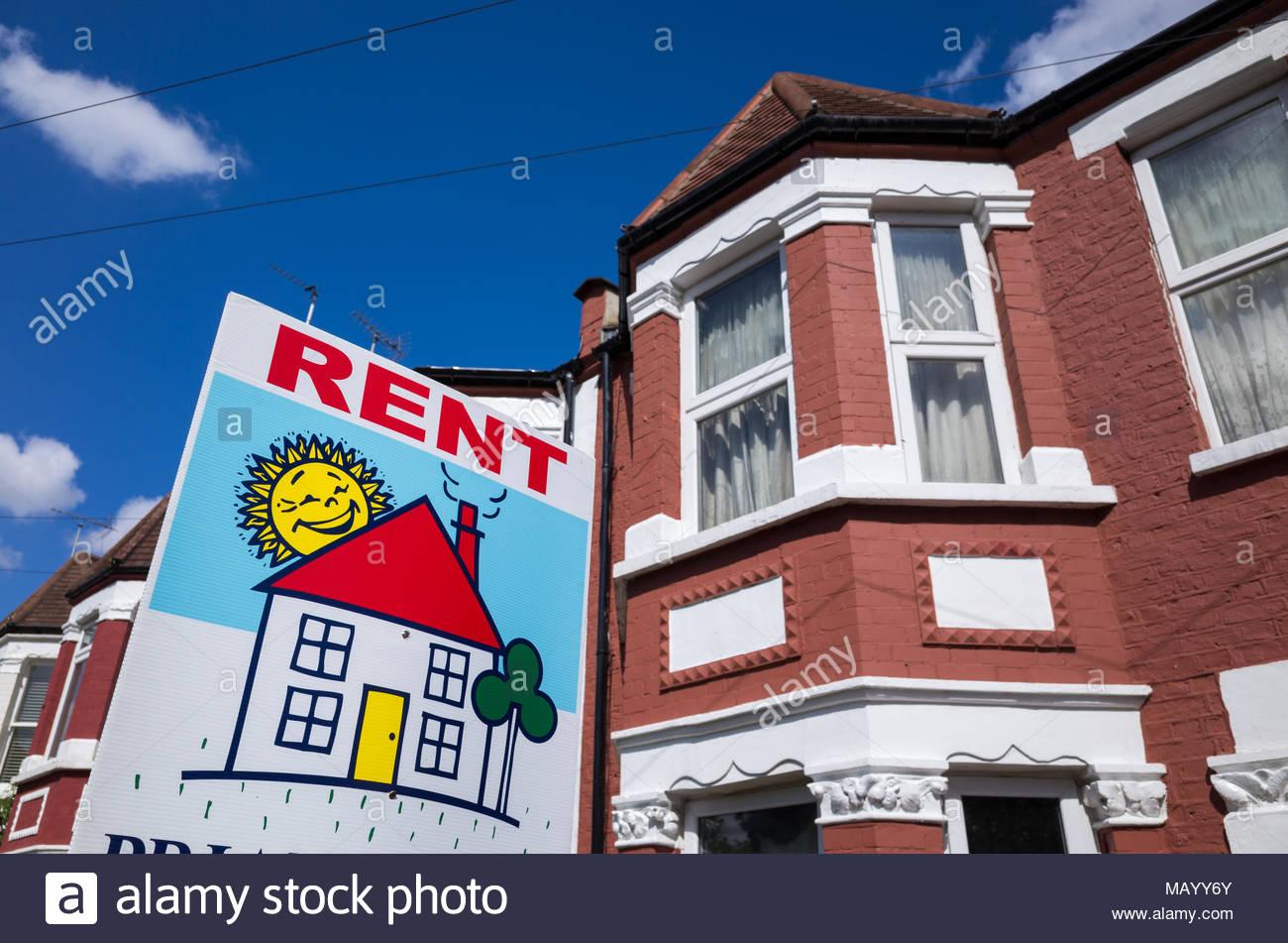 Estate agent rent sign outside terraced house, UK, London - Stock Image