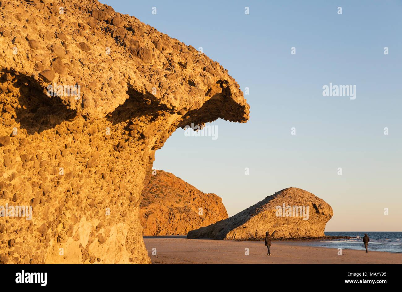 Fossilized lava tongues and walls at the beach Playa del Monsul, Nature Reserve Cabo de Gata-Nijar, Almeria province, Andalusia - Stock Image