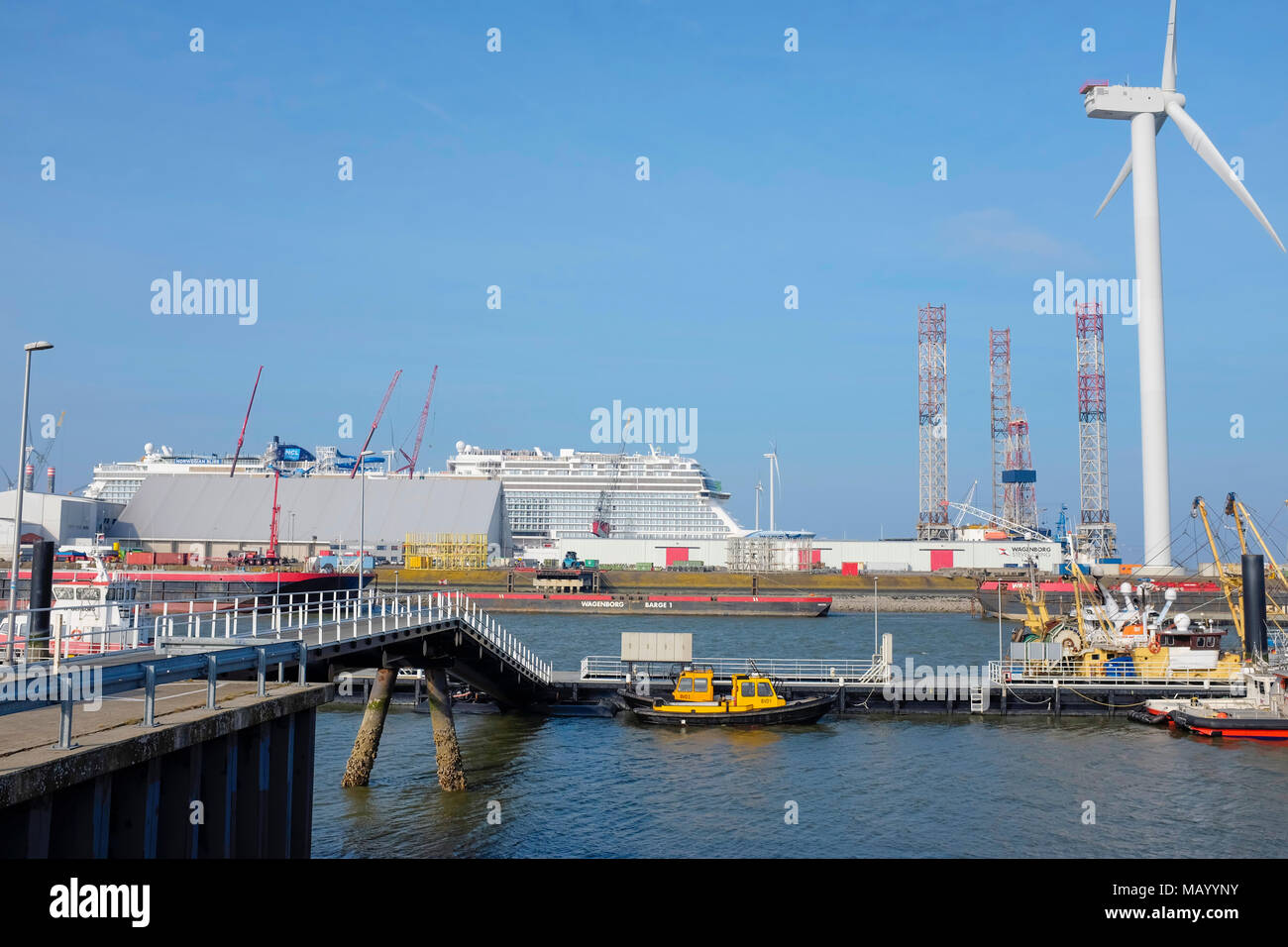 Norwegian Bliss Cruise Ship receiving final constructional works in Port at Eemshaven, The Netherlands. - Stock Image