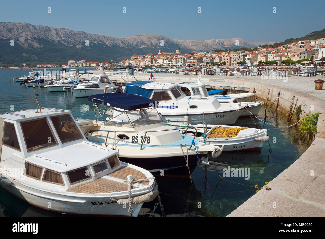Motor boats in the harbour, Baska, island Krk, Kvarner Gulf Bay, Croatia - Stock Image