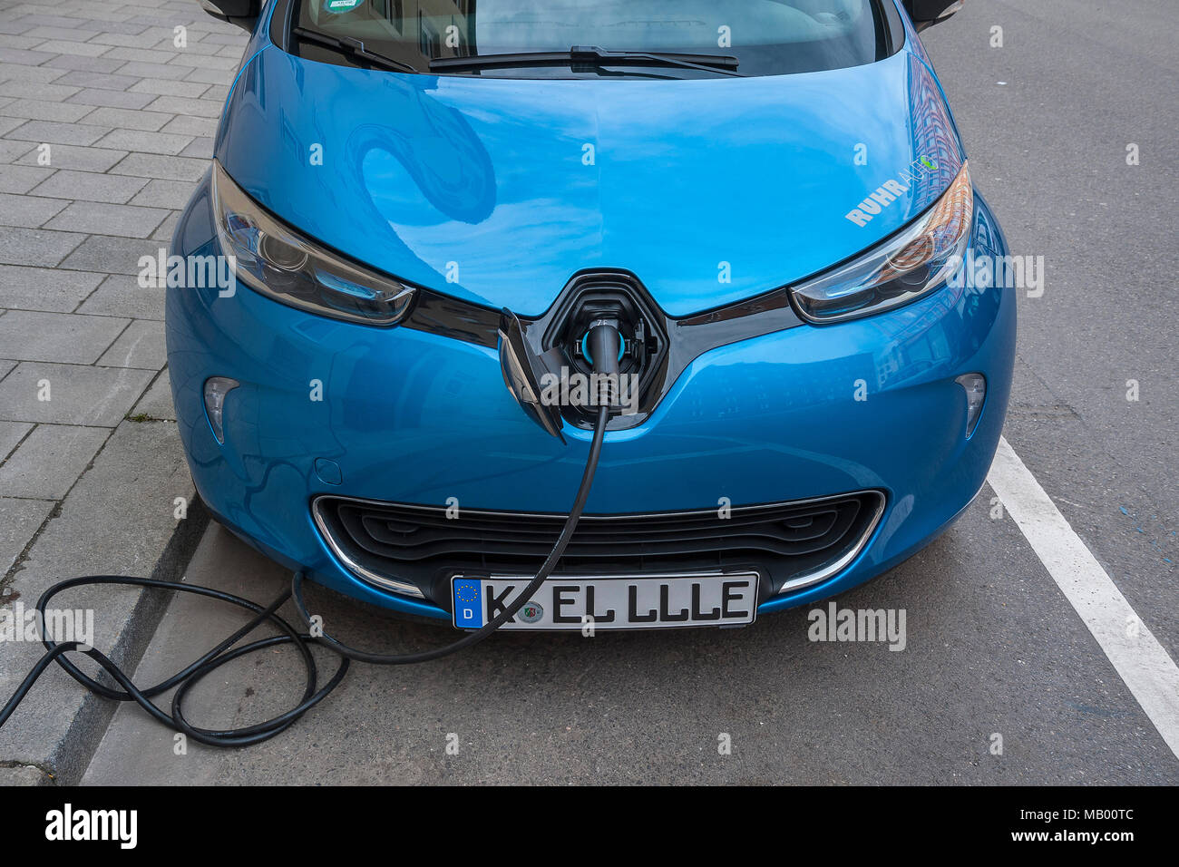 Electric car is charging charging cable, Munich, Bavaria, Germany - Stock Image