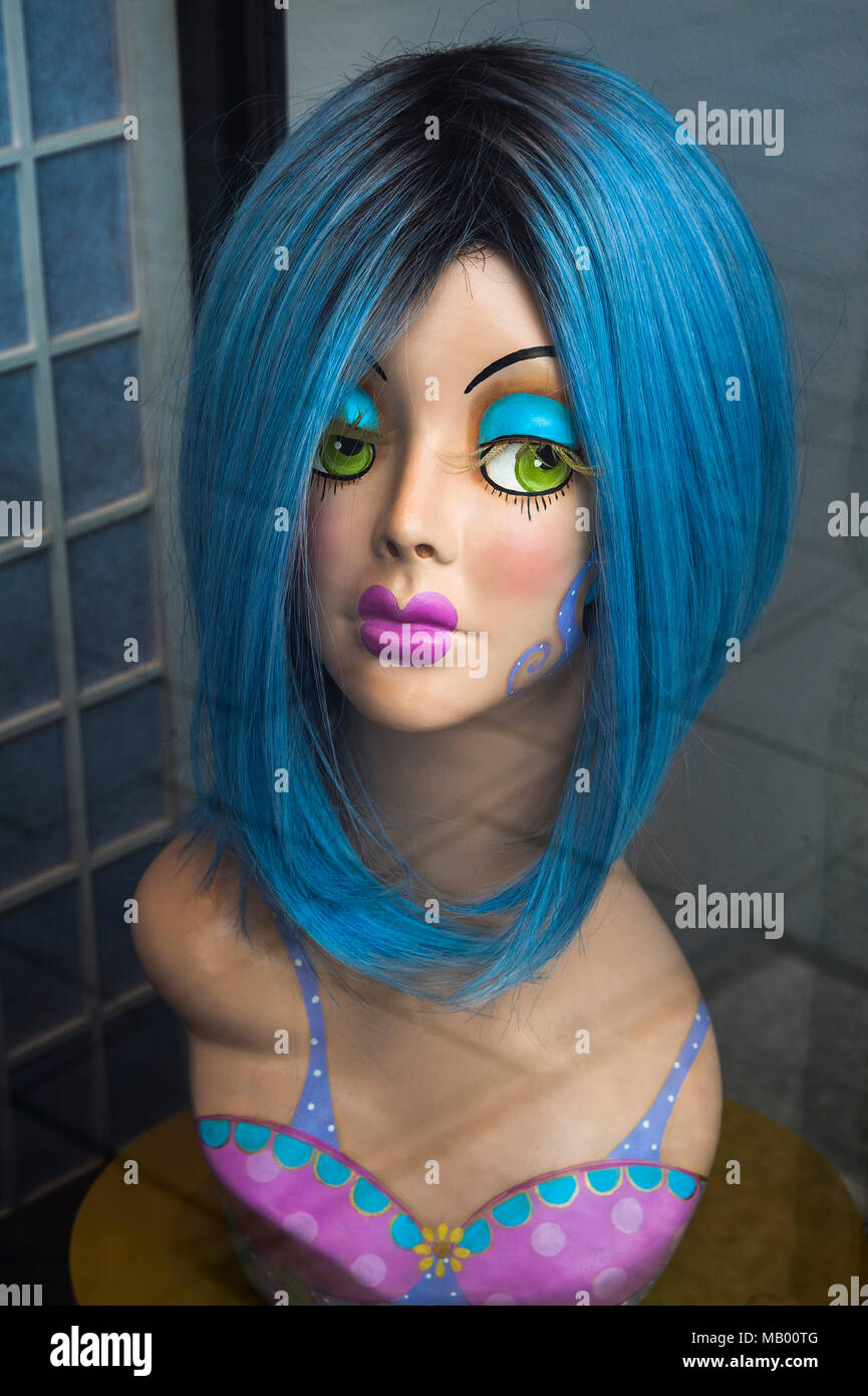 Head of a mannequin with blue wig, Munich, Bavaria, Germany - Stock Image