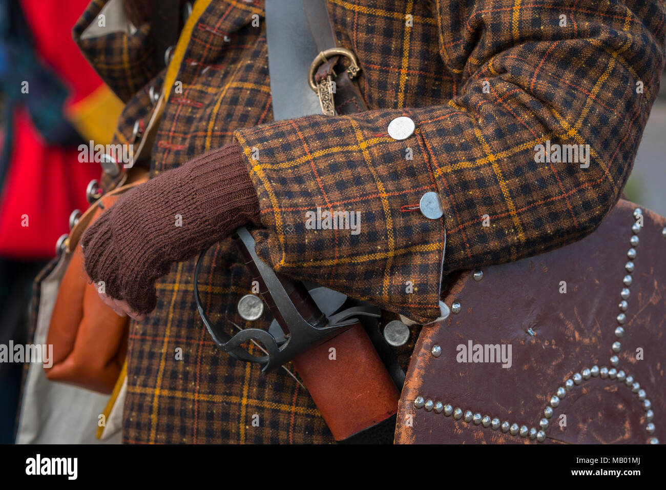 Scottish supporter of Bonnie Prince Charlie with Targe or shield and sword at a reenactment. - Stock Image