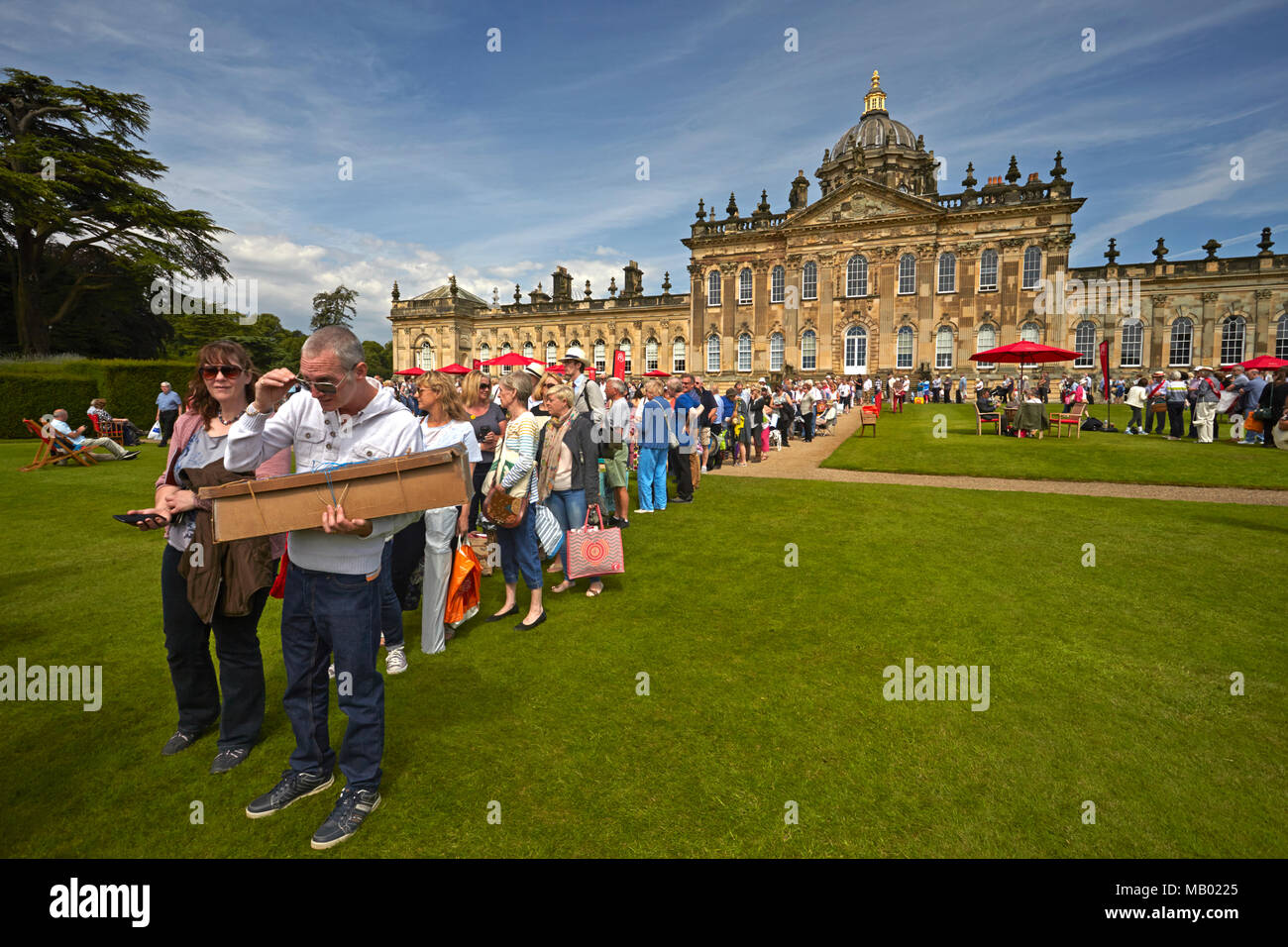 Members of the general public queuing at the filming of the BBC television programme Antiques Roadshow in the grounds of Castle Howard. - Stock Image