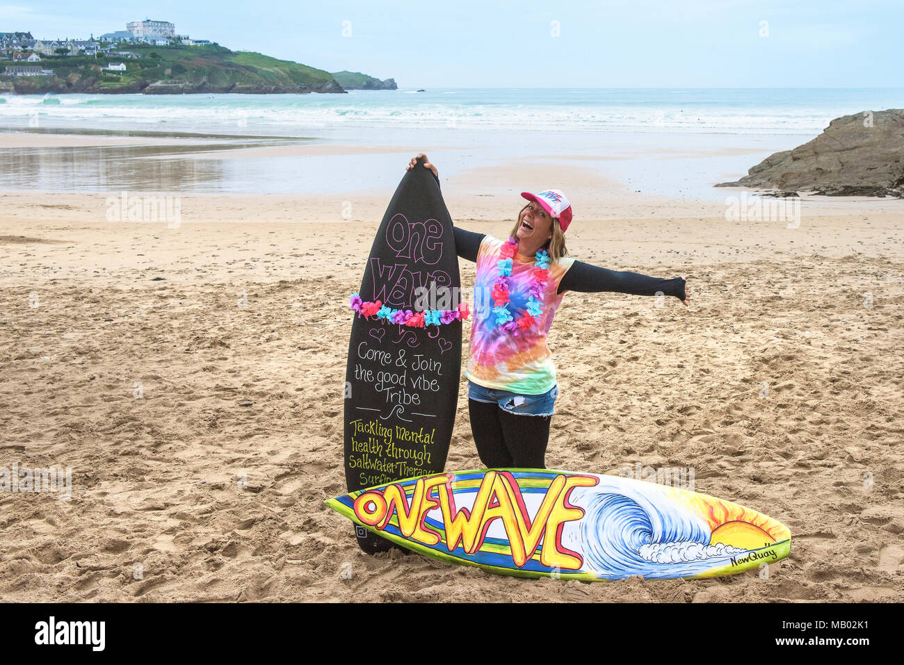 Lauren Turner one of the organisers of Surf Betty's Festival held in Newquay in Cornwall to help empower women through surfing and fitness. - Stock Image