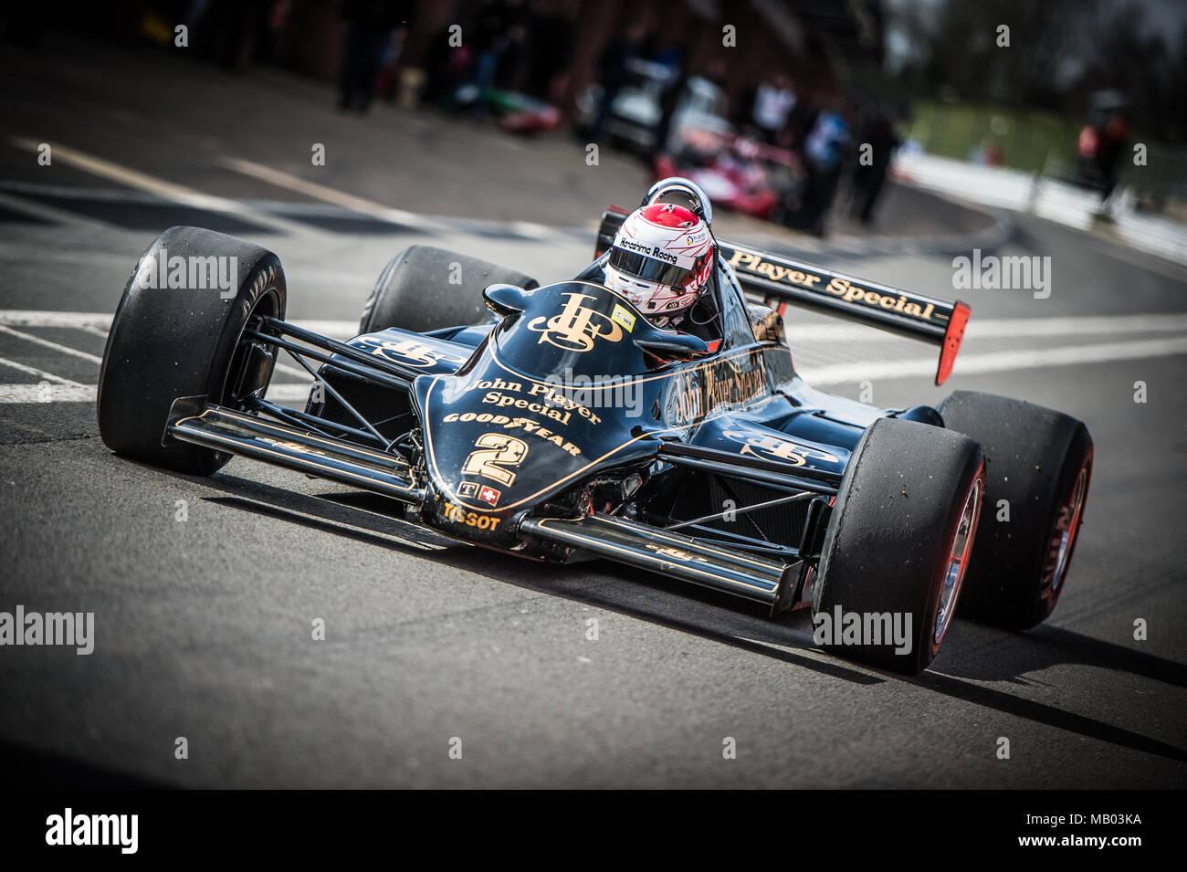 Japanese racing driver Katsu Kubota in the JPS Lotus 91/7 F1 car during the Master Historic Racing Test Day at Brands Hatch Circuit - Stock Image