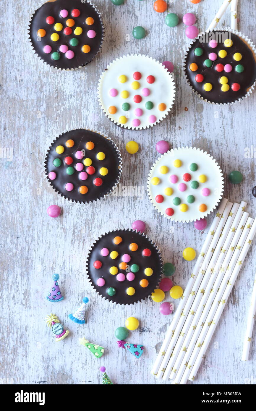 Cupcakes with sugar coated candy - Stock Image