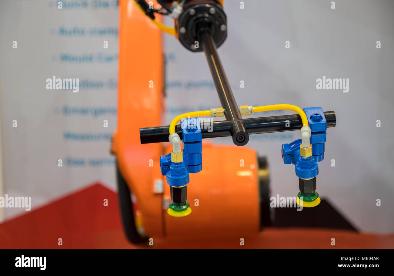 Robot arm for glass pick and place for manufacturing process - Stock Image
