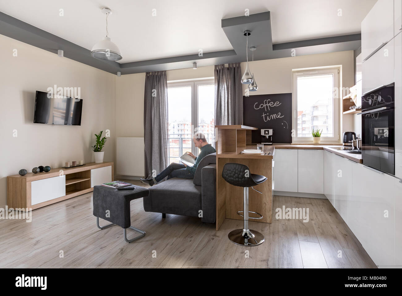 Functional And Contemporary Living Room With Kitchen Combined Stock Photo 178868340 Alamy