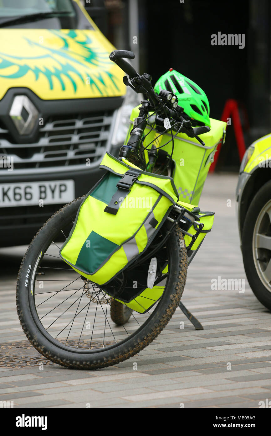 Three medical vehicles parked together, one ambulance van, one bicycle and one medical car attend a emergency in Kingston. - Stock Image