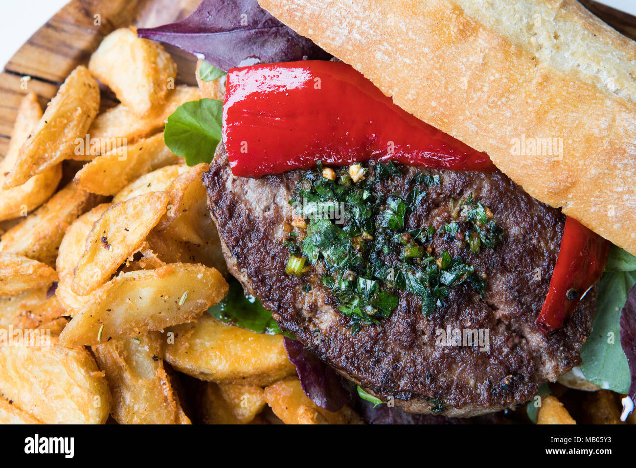 Posh burger and chips. - Stock Image