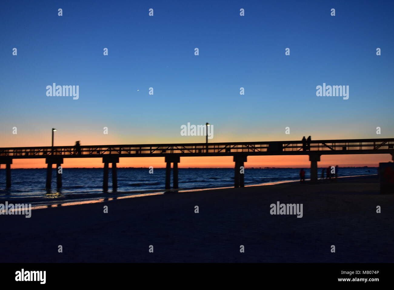 Sunset behind the Pier - Stock Image