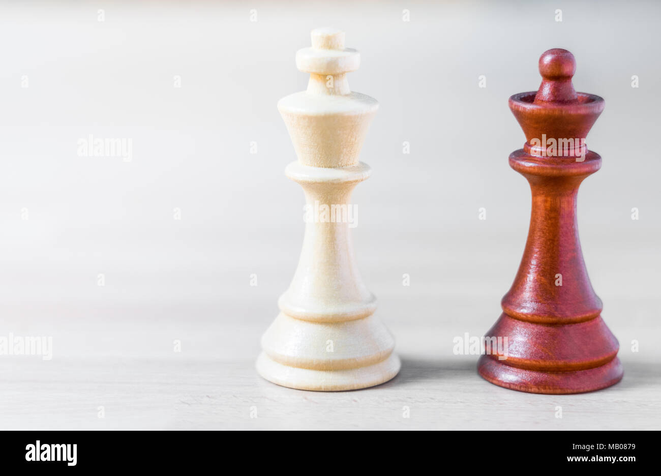 A white king and a black queen chess pieces