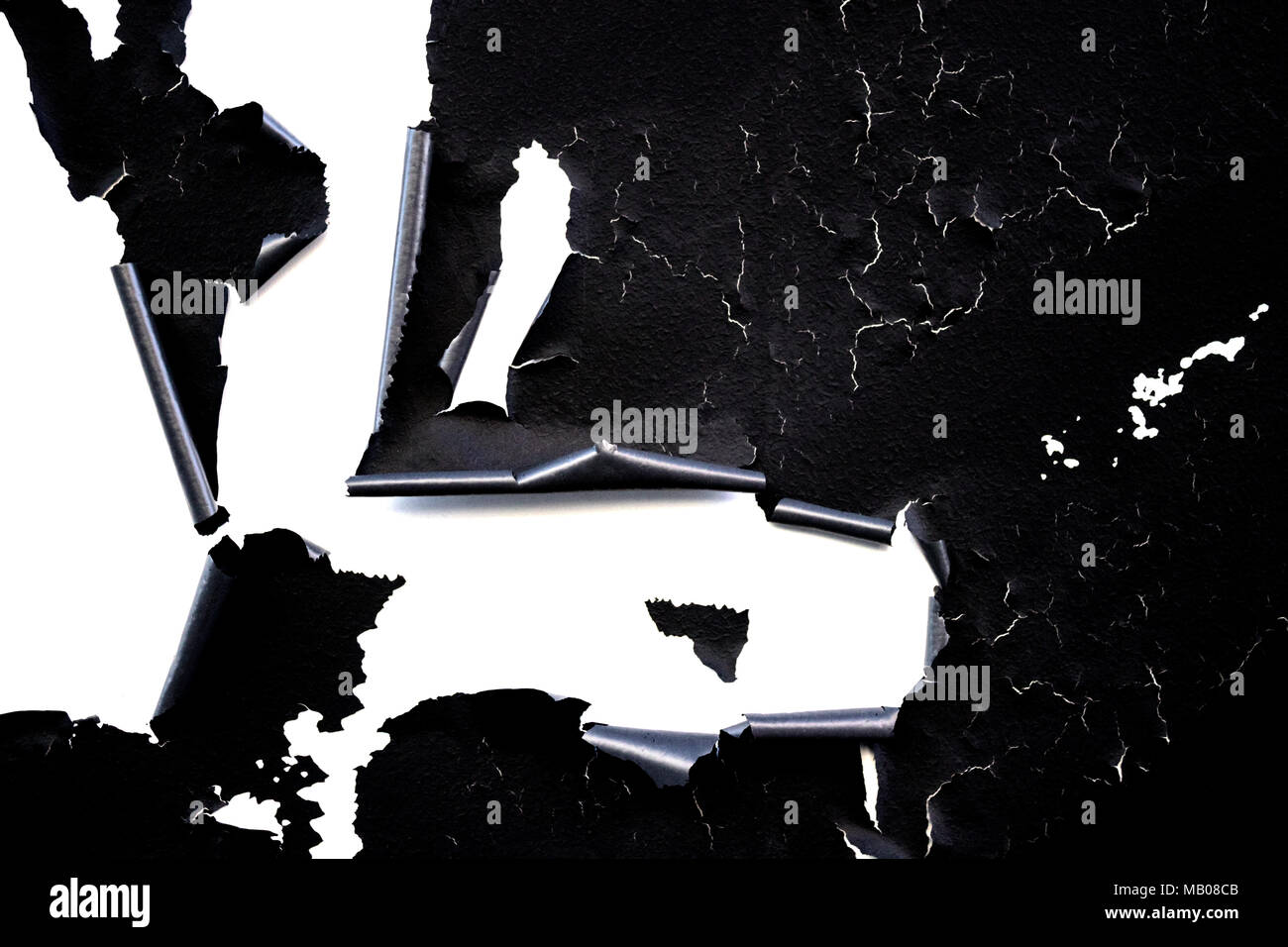 Old flaky black paint peeling off isolated on white Cracks scrapes