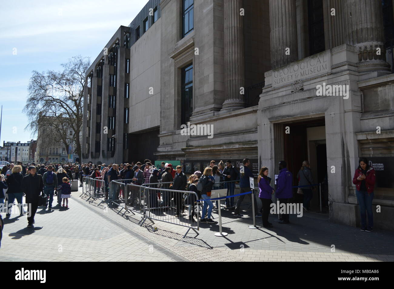 A queue outside the east entrance of the Natural History Museum in South Kensington, London - Stock Image