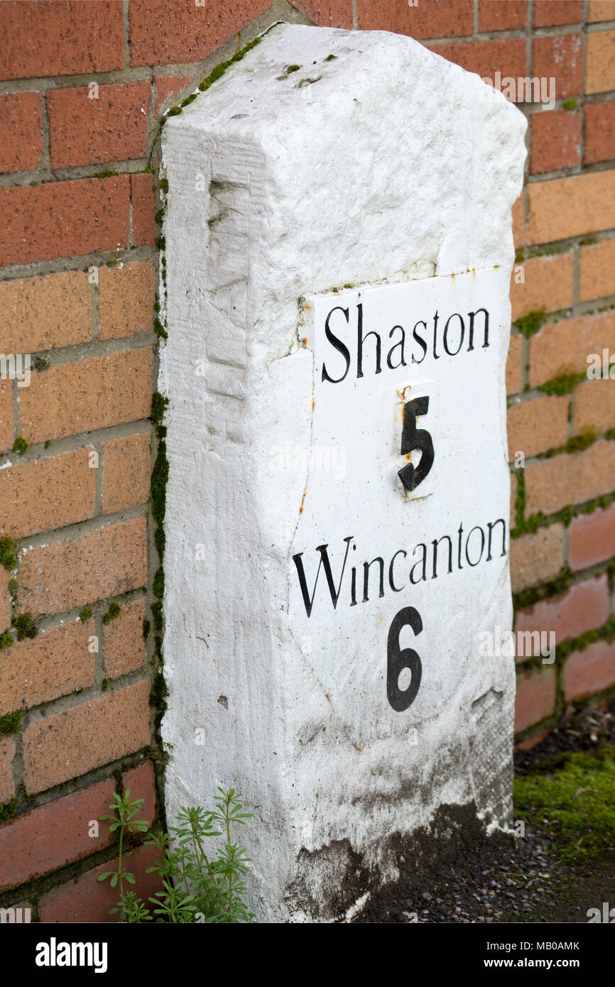 A milestone on Wyke Rd Gillingham Dorset England UK, indicating 6 miles to Wincanton in Somerset and 5 miles to Shaston-the old name for Shaftesbury i - Stock Image