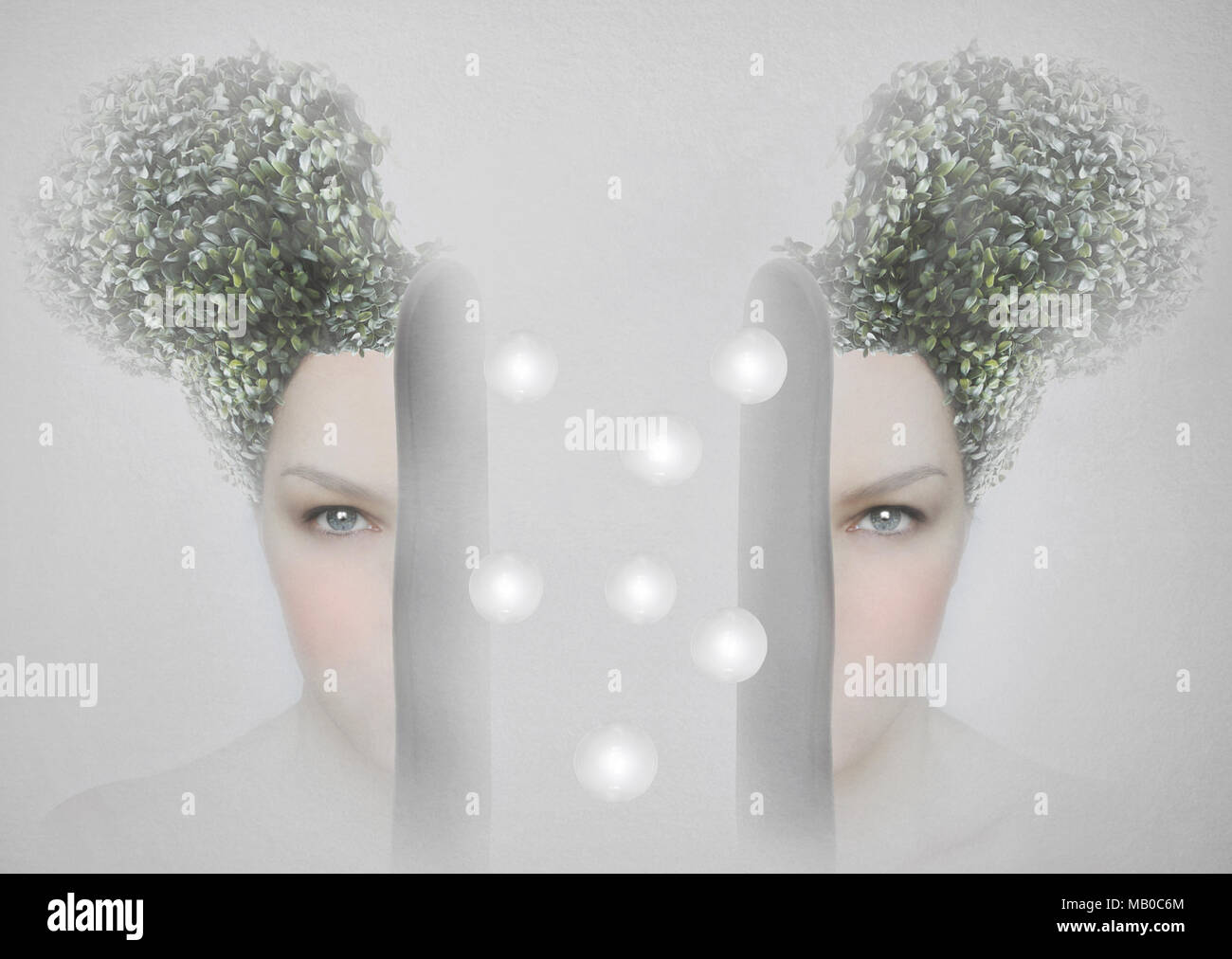 Female artistic portrait divided in two parts, surreal concept - Stock Image