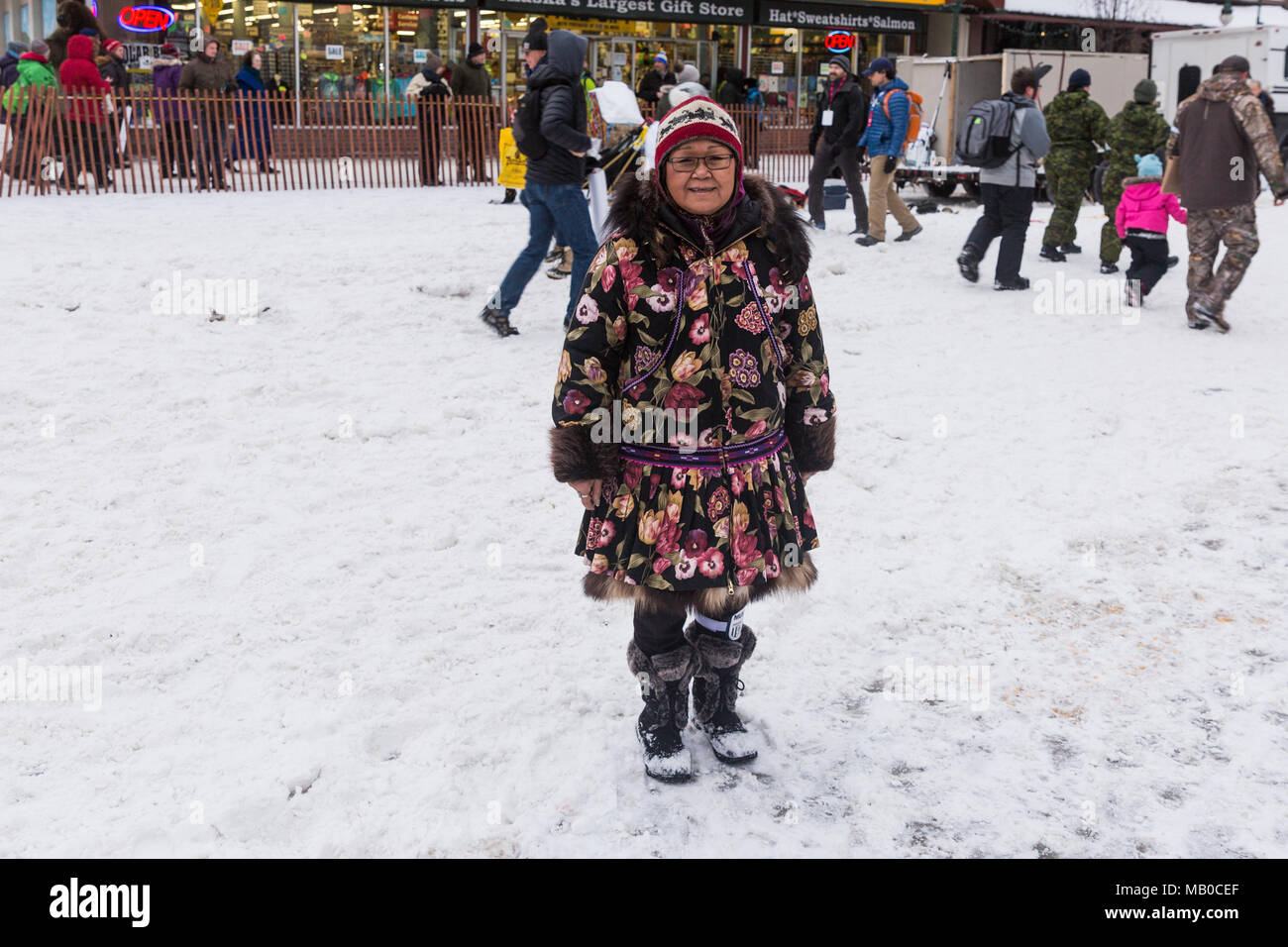 Native Alaskan at start of 2018 Iditarod in Anchorage Alaska - Stock Image