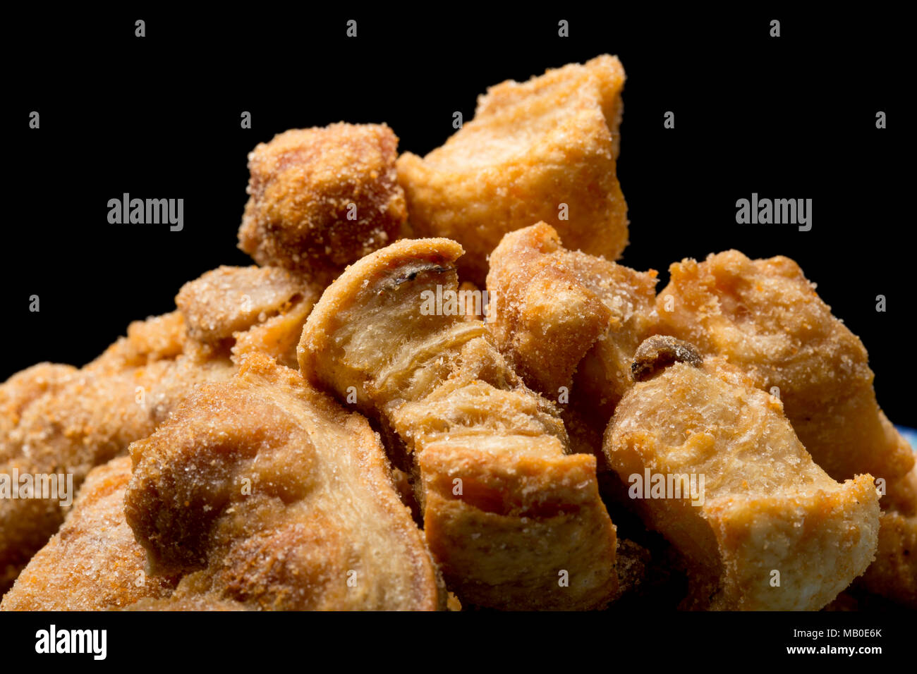 Pork scratchings from a packet bought in a supermarket. UK - Stock Image