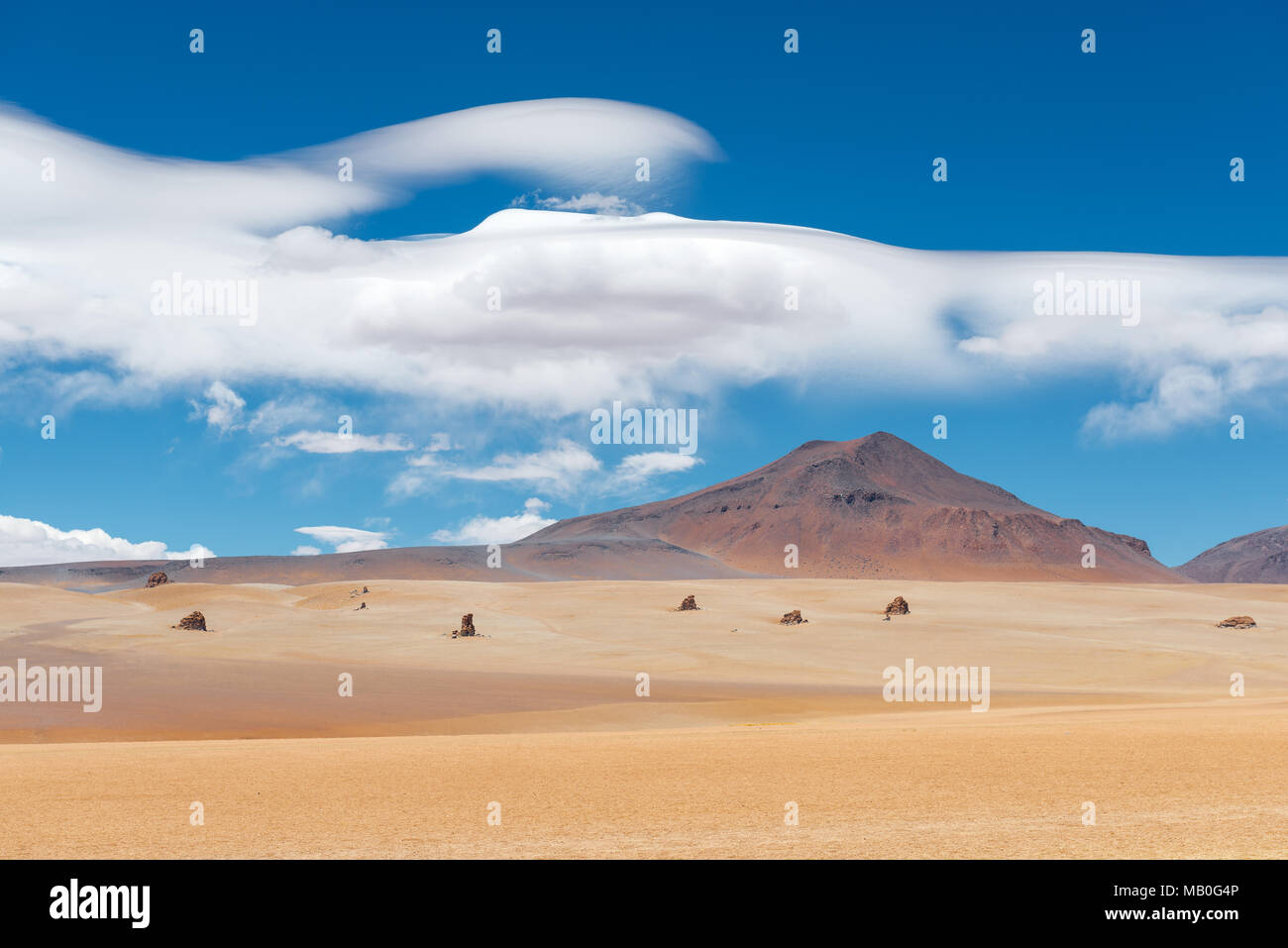The Dali Desert near the Uyuni Salt Flat (Salar de Uyuni) with rock formations and clouds that could have been drawn by the master himself, Bolivia. Stock Photo