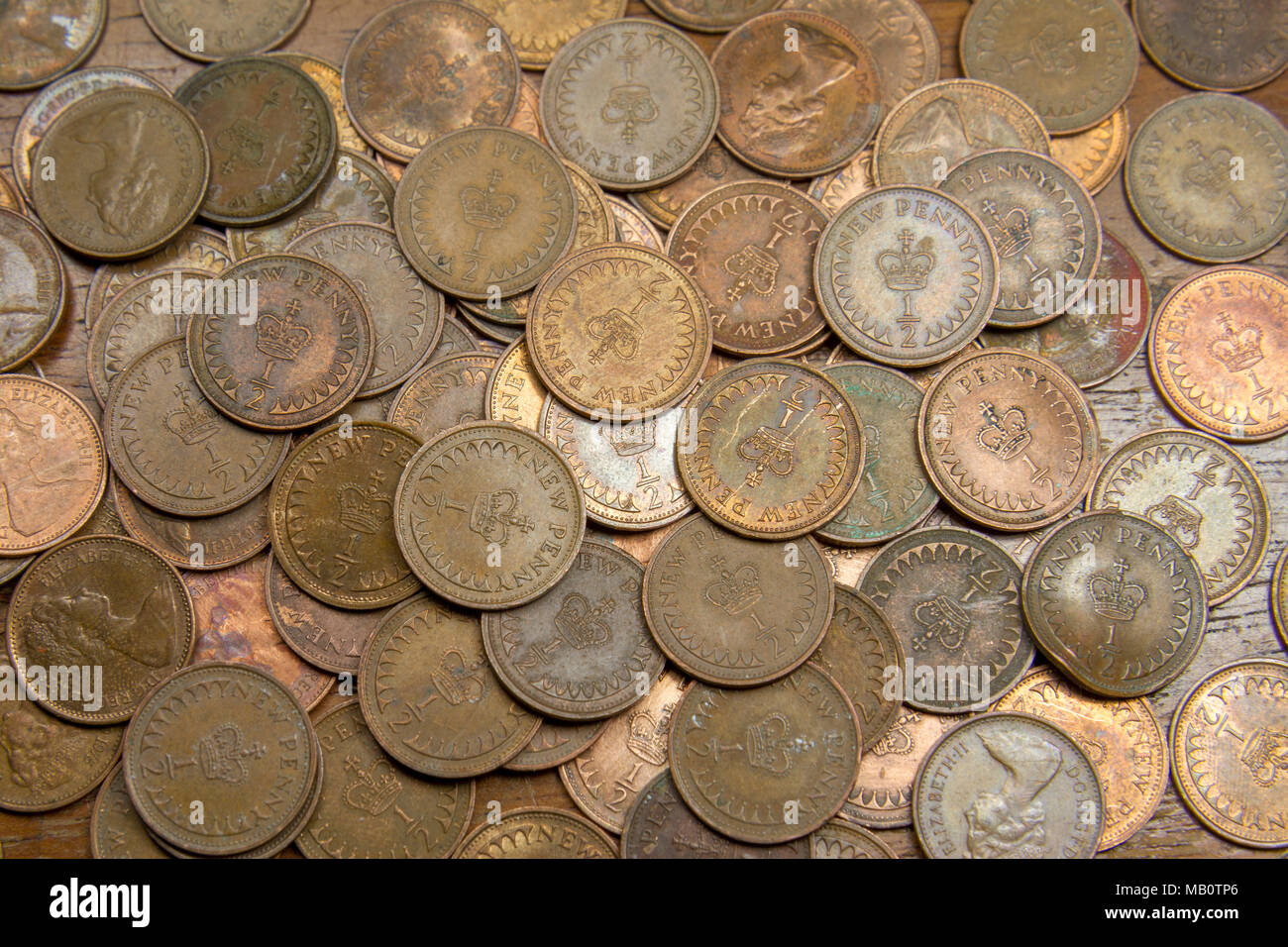 A large collection of half pennies. The coin was demonetised and withdrawn from circulation in December 1984. - Stock Image