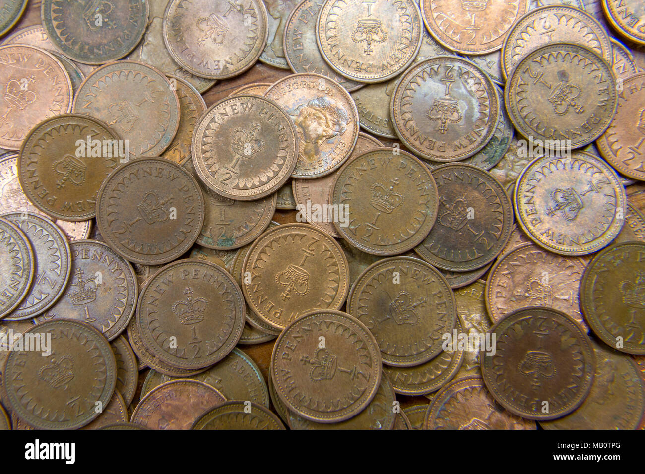 A large collection of half pennies. The coin was demonetised and withdrawn from circulation in December 1984. Stock Photo
