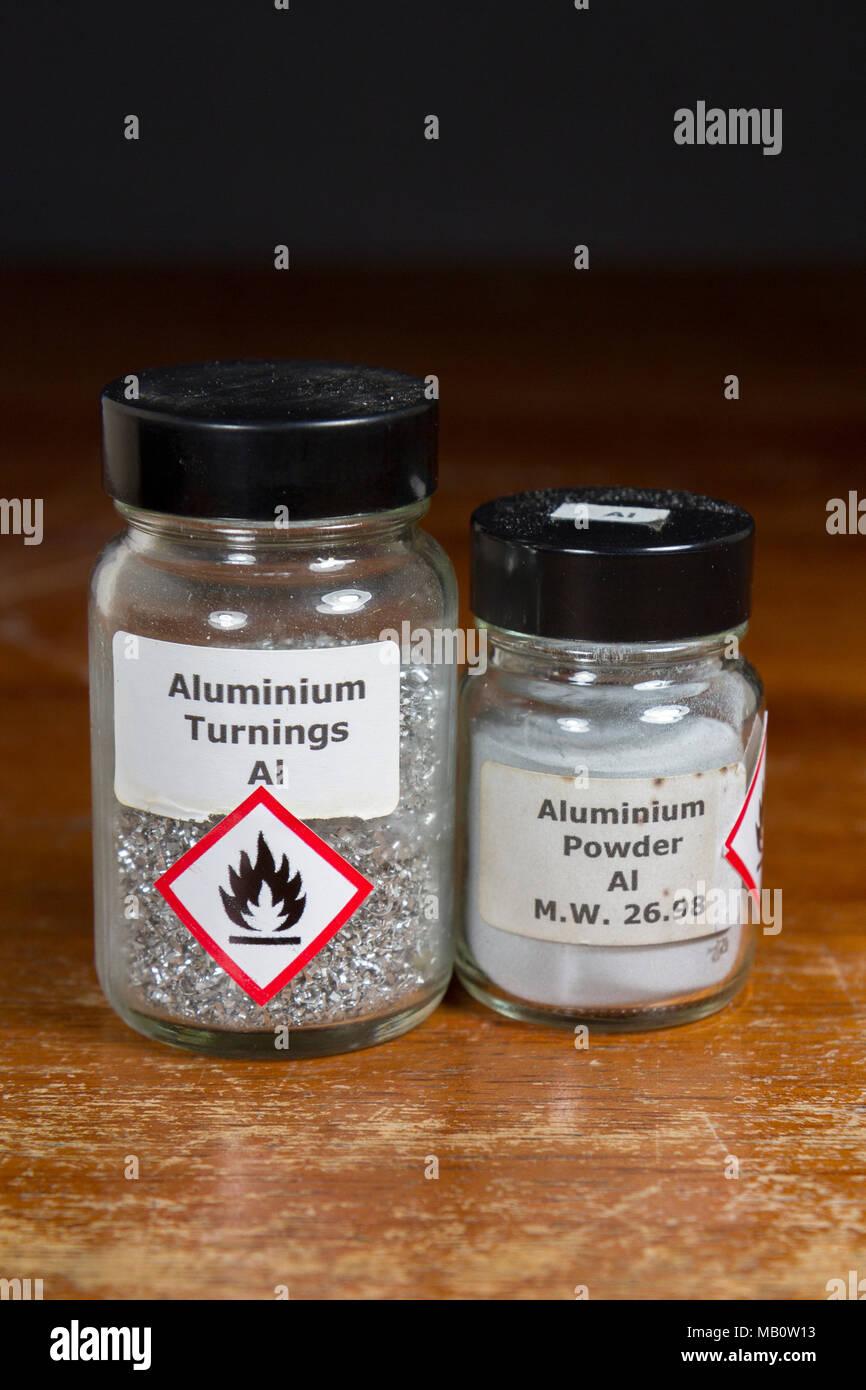 Jars of aluminium turnings and aluminium powder as used in a UK secondary school, London, UK. - Stock Image