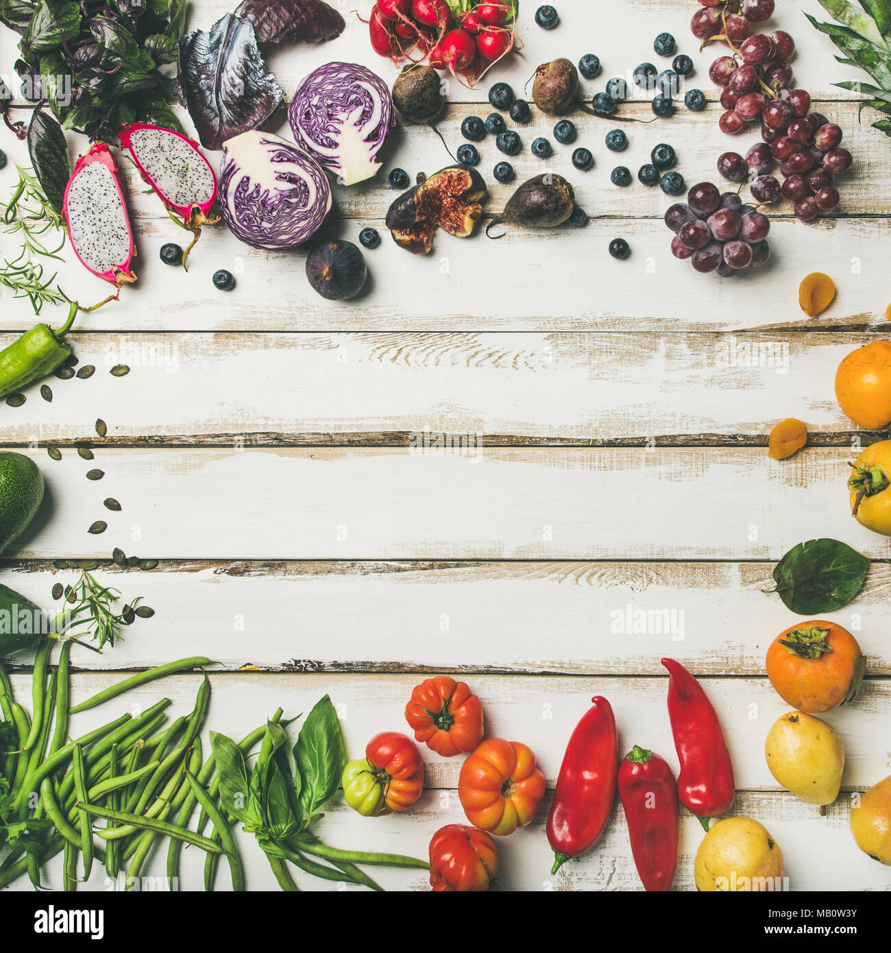 Flat-lay of fresh fruit, vegetables, greens and superfoods, square crop - Stock Image