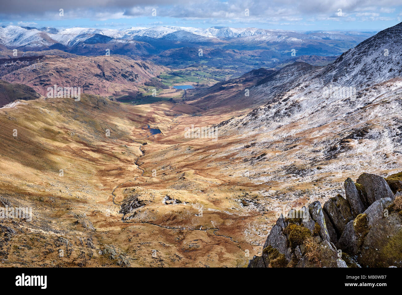 Cumbria / UK - April 5th 2018: The English Lake District and the Tilberthwaite fells with Little Langdale in the distance Stock Photo