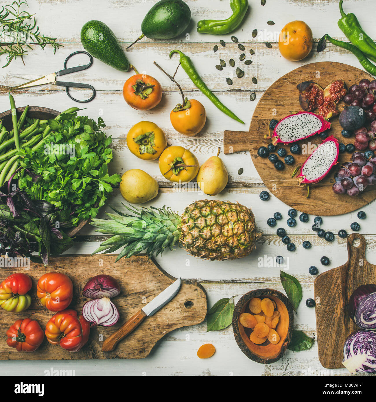 Helathy vegan food cooking background with uncooked fruites and vegetables Stock Photo