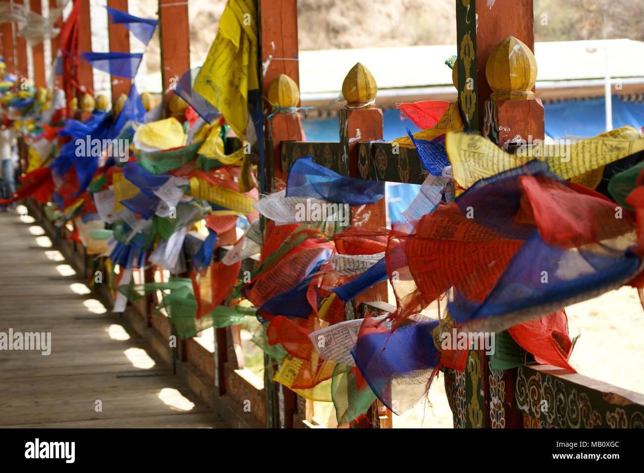 Prayer flags on cantilever bridge in Thimpu, Bhutan - Stock Image