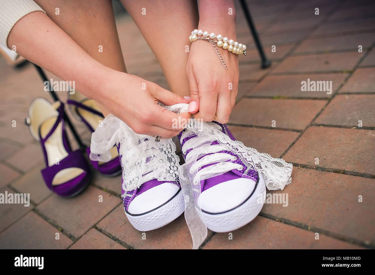 Choosing sneakers over high heels Stock