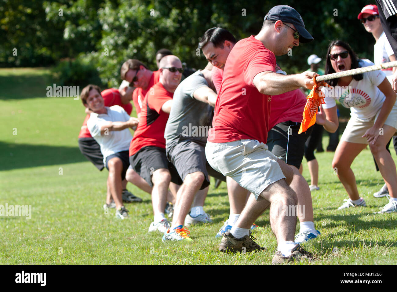 A team pulls in the tug-of-war competition at A Day For Kids, an event where adults play kids games for charity on September 7, 2013 in Atlanta, GA. - Stock Image