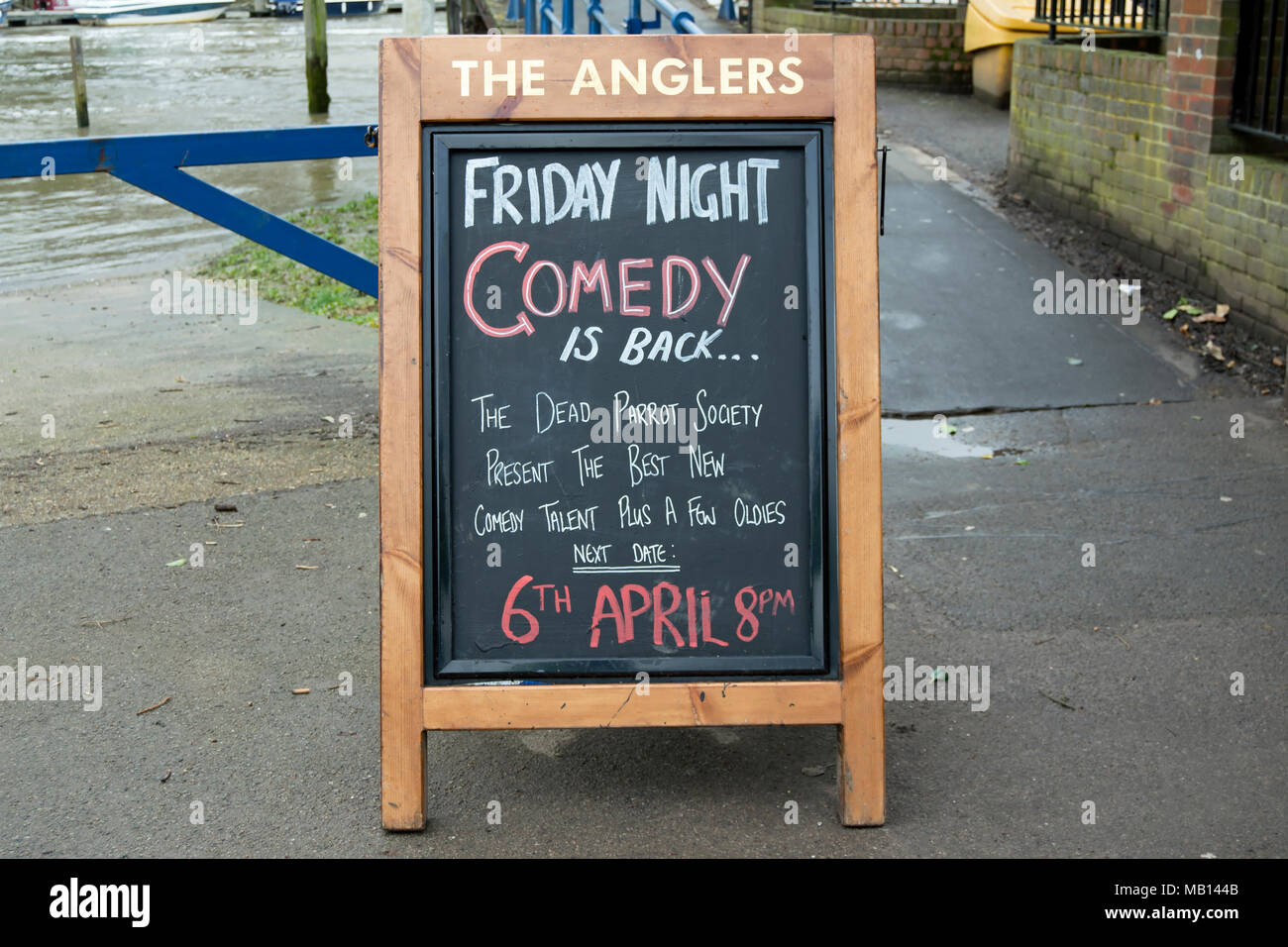 information board advertising a friday comedy night at the anglers pub,  teddington, middlesex, england Stock Photo