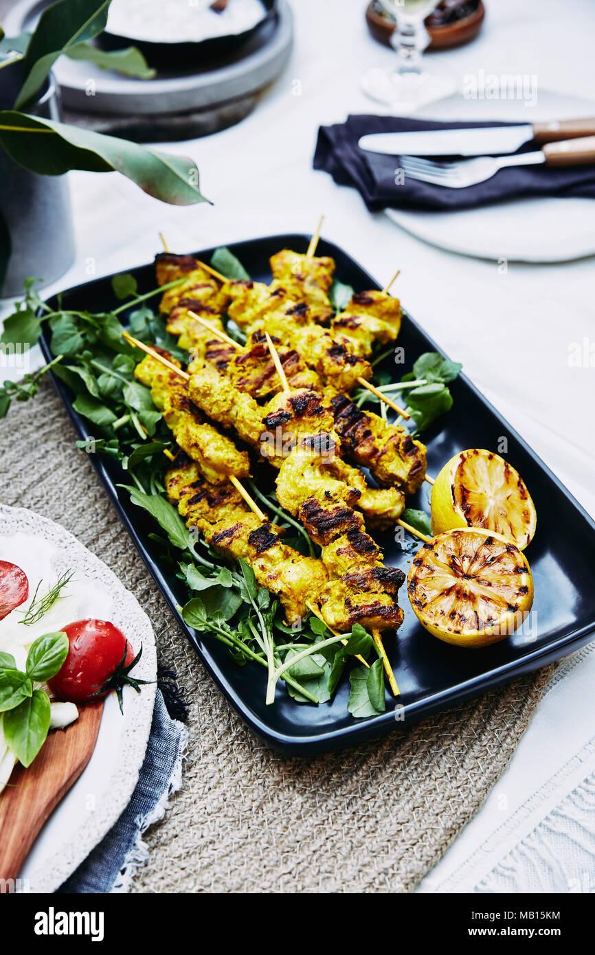 BBQ turmeric chicken skewers. - Stock Image