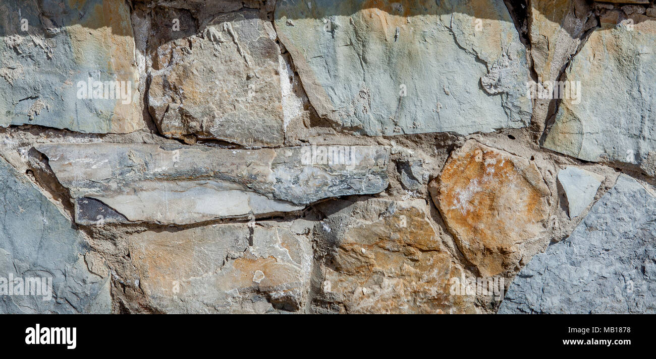 Wall from large stone textured basalt. Good background for wallpaper - Stock Image