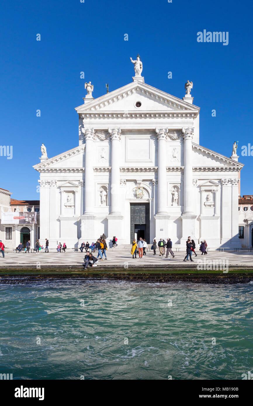 Front facade of San Giorgio Maggiore from Giudecca Canal, Venice, Veneto, Italy. This church was designed by Palladio  to face the setting sun - Stock Image