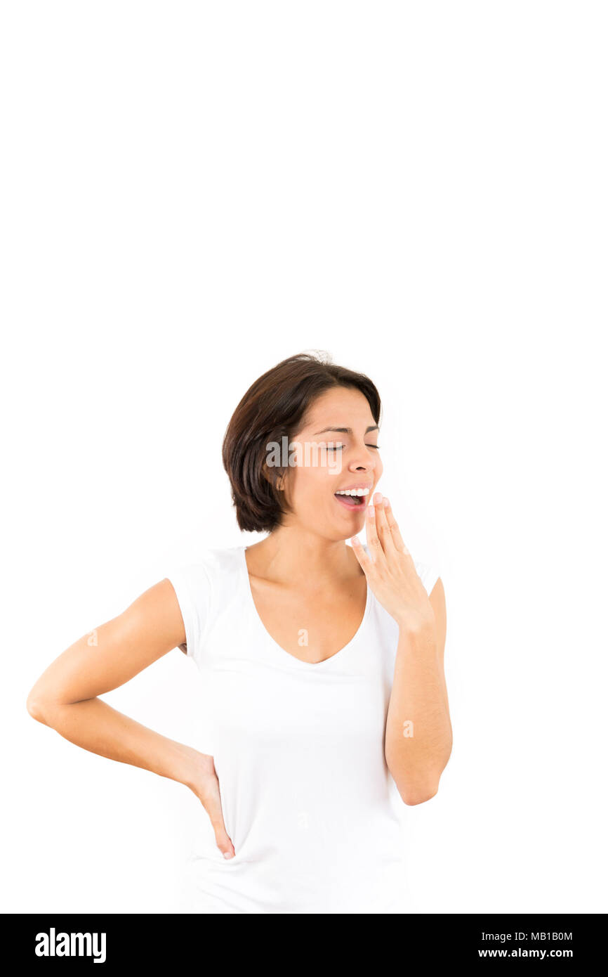 Portrait of Tired Young Woman Over White Background Stock Photo