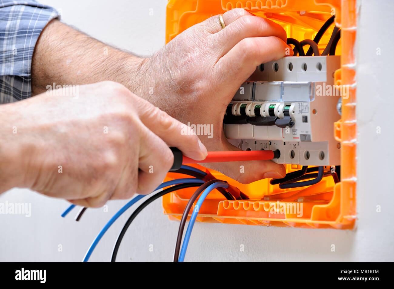 Electrician technician working on a residential electrical panel ...