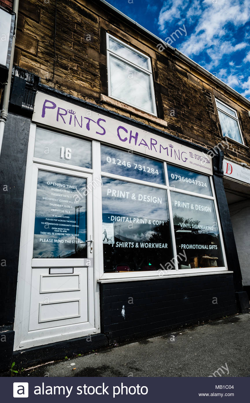 Prints Charming a small unusual named print & design shop on the High Street using a play on words as its title in Holmewood, Chesterfield England UK Stock Photo