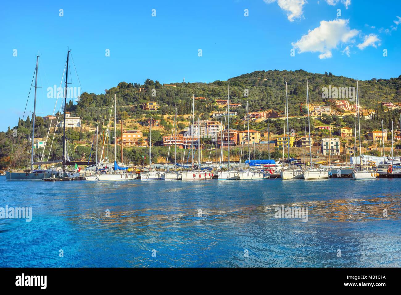 Waterfront of Porto Santo Stefano harbor. Monte Argentario, Tuscany, Italy - Stock Image